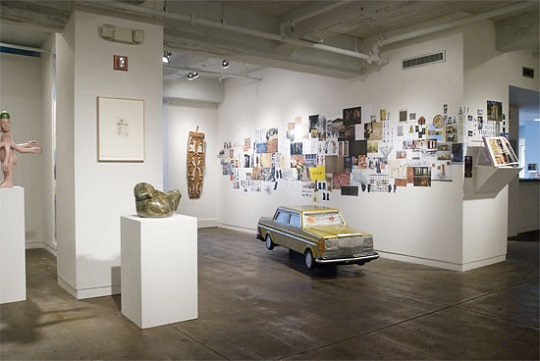 Magiciens de la Terre, installation with Coffin Car by Kane Kwei. Photo courtesy of Fleisher-Ollman Gallery..jpg